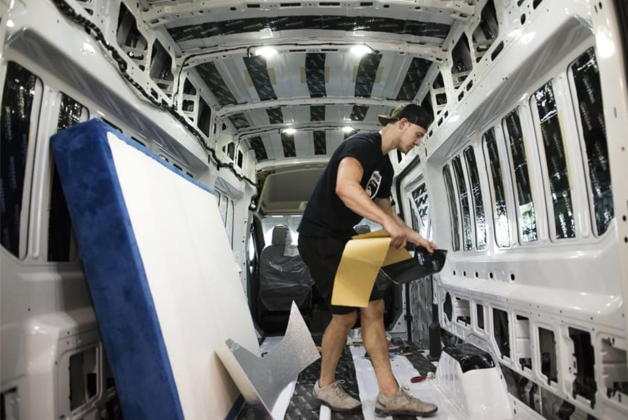 Brandon Anderson, a builder at Van Haus Conversions, starts the initial work of customizing a van at its West Minnehaha workshop. The custom van industry in the region has grown significantly in recent years, fueling companies such as Van Haus that charge at least $30,000 to outfit a van.