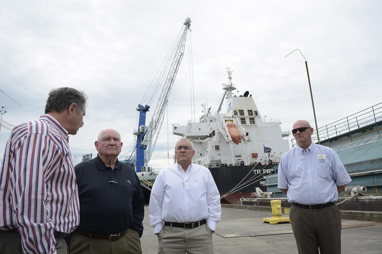Bruce Reed of Tidewater Transportation & Terminals, from left, talks with Sonny Perdue, Rob Rich of Shaver Transportation and Mark Wilson of Port of Kalama on Wednesday morning, July 4, 2018.