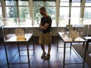 Andy Trapani of San Jose, Calif., views the Na Kanaka art installation Friday afternoon at the Fort Vancouver Visitor Center.