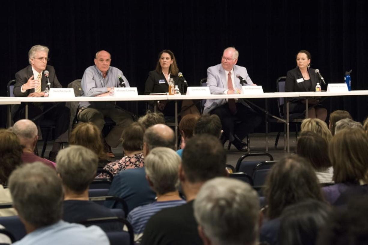 3rd Congressional District candidates, from left, David McDevitt, Michael Cortney, Carolyn Long, Earl Bowerman and Dorothy Gasque participated in the League of Women Voters' first congressional forum Thursday evening. Candidates addressed topics including immigration, federal spending and campaign reform.