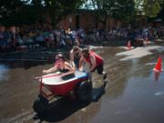 The Bathtub Bandits, steered by Tanya Groth and pushed by Tristian Groth and Greg Irwin, win a heat by a large margin during the Camas Days bathtub races on Saturday. The Bathtub Bandits won first place overall for the second year in a row.