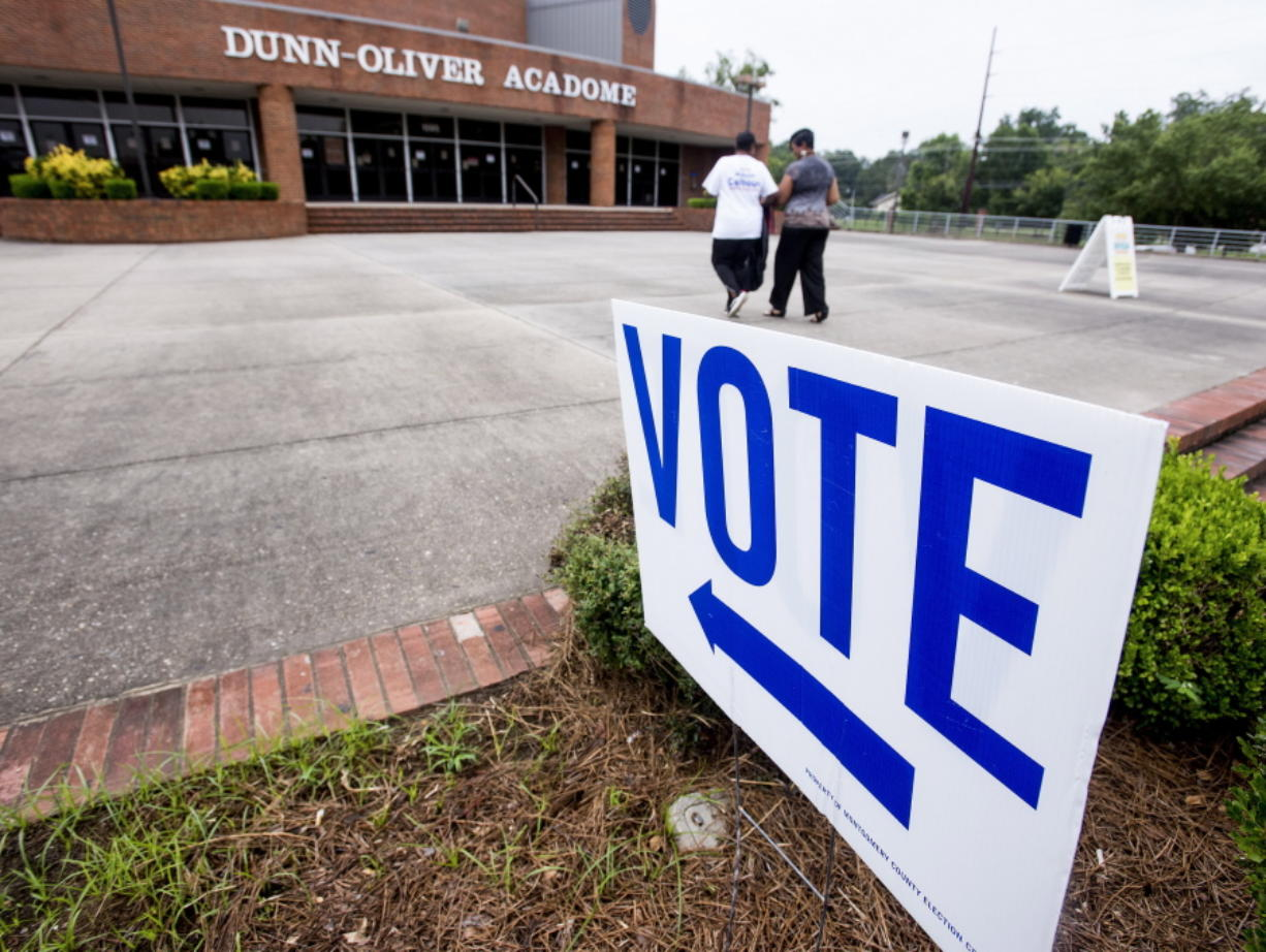 Voters make their way into the polling station Tuesday on the Alabama State University campus in Montgomery, Ala., to vote in a runoff election for a U.S. House of Representatives seat.