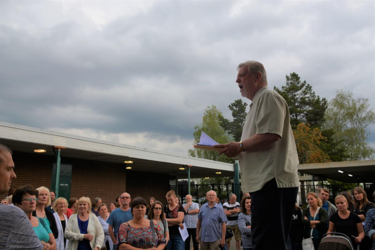 """Doug Sheddy speaks to a crowd opposing the adoption of """"High School FLASH"""" Monday at Battle Ground Public Schools. Critics of the curriculum say its lessons on gender identity and sexual orientation are not appropriate for children."""