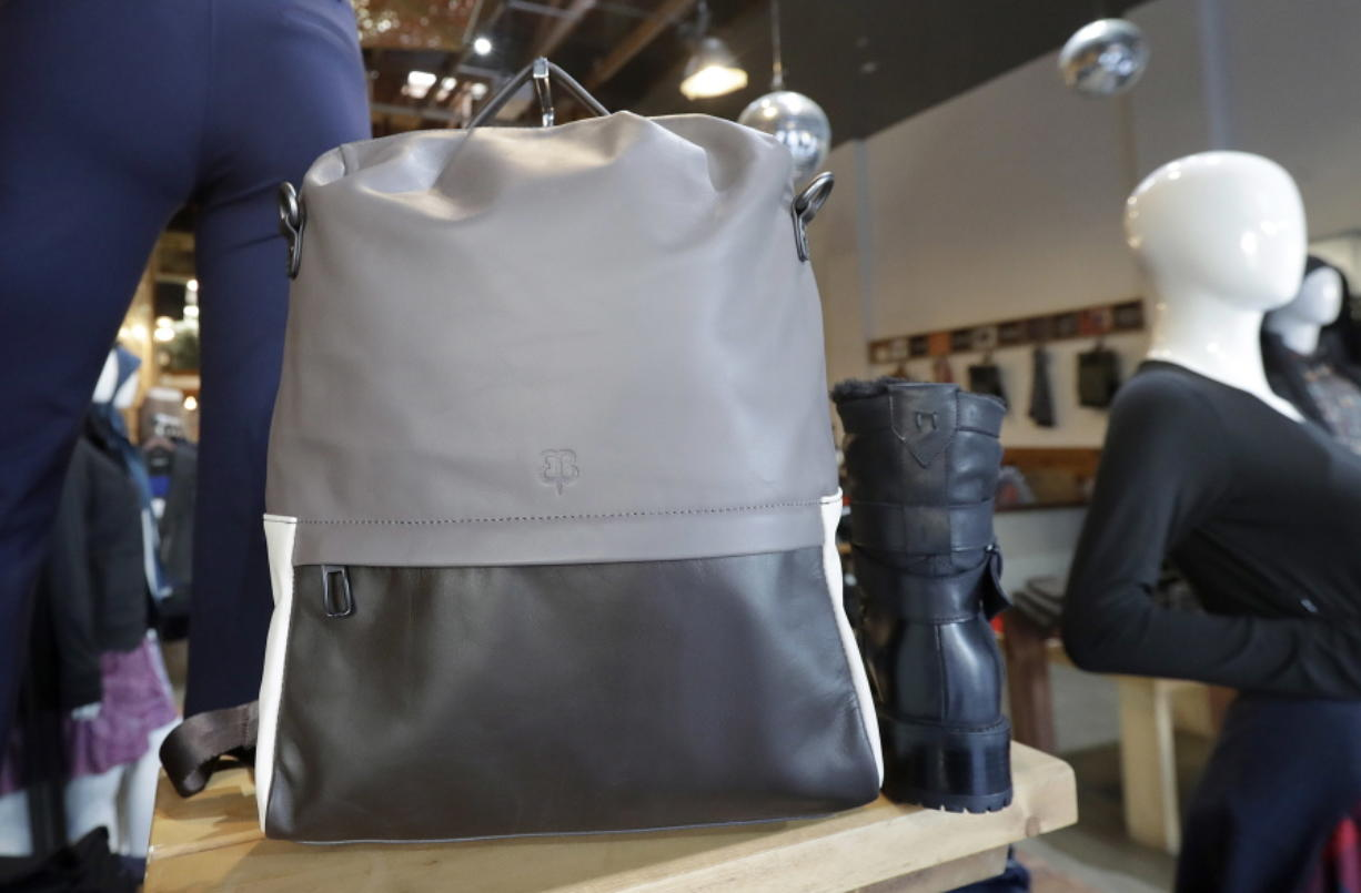 In this Feb. 15, 2018 photo, a handbag designed by Tiffany Tam is displayed on a shelf at a Betabrand store in San Francisco. Betabrand represents one of the most dramatic examples of how companies _ big and small _ are starting to use digital technology to reinvent and speed up the process of designing and selling clothing to shoppers in the age of Amazon. (AP Photo/Jeff Chiu)
