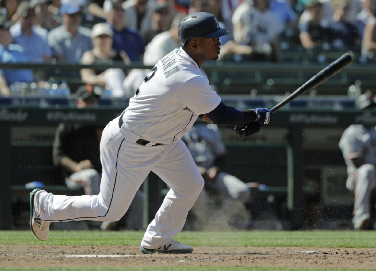 Seattle Mariners' Jean Segura watches his tie-breaking RBI single during the eighth inning of a baseball game against the San Francisco Giants, Wednesday, July 25, 2018, in Seattle. The Mariners won 3-2. (AP Photo/Ted S.