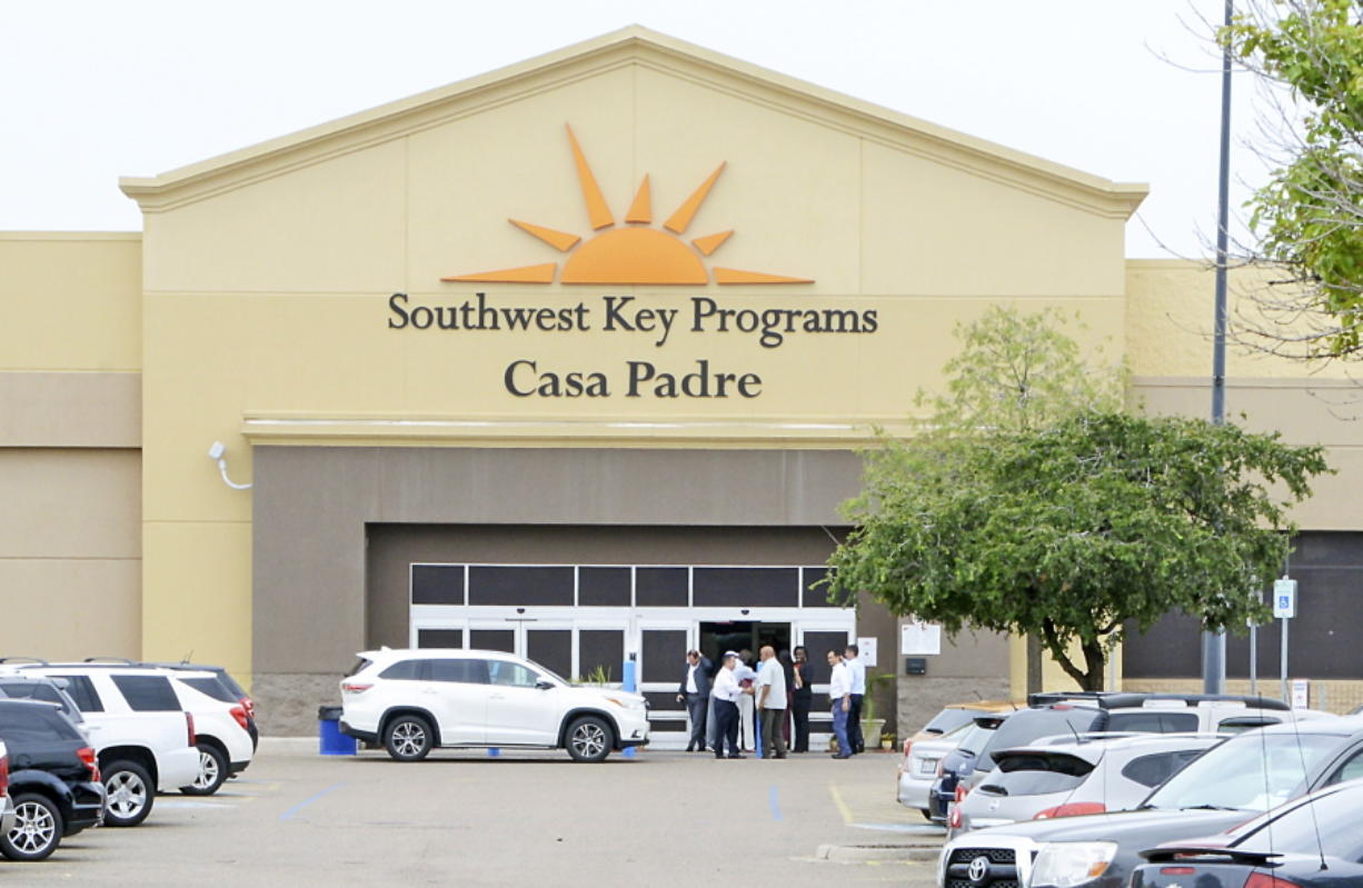 """FILE - In this June 18, 2018 file photo, dignitaries take a tour of Southwest Key Programs Casa Padre, a U.S. immigration facility in Brownsville, Texas, where children who have been separated from their families are detained. The American Civil Liberties Union says it appears the Trump administration will miss a Tuesday, July 10 deadline to reunite young children with their parents in more than half of the cases. The group said the administration provided it with a list of 102 children under 5 years old who must be reunited by Tuesday under an order by U.S. District Judge Dana Sabraw in San Diego. It said in a statement that it """"appears likely that less than half will be reunited"""" by that deadline."""