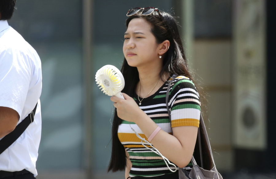 Death Toll Climbs As Japan Wilts Under Heat Wave  The Columbian-6353