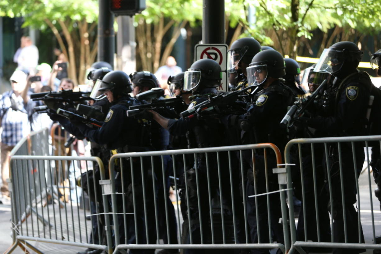 Police disperse protesters Saturday as problems occurred when two groups — Patriot Prayer and antifa — marched through the streets in Portland. Police ordered participants in a march by Patriot Prayer to leave after officers saw assaults and projectiles being thrown.