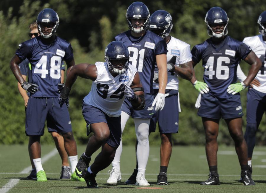 db4b54997 Seattle Seahawks defensive end Rasheem Green (94) takes part a drill during  NFL football