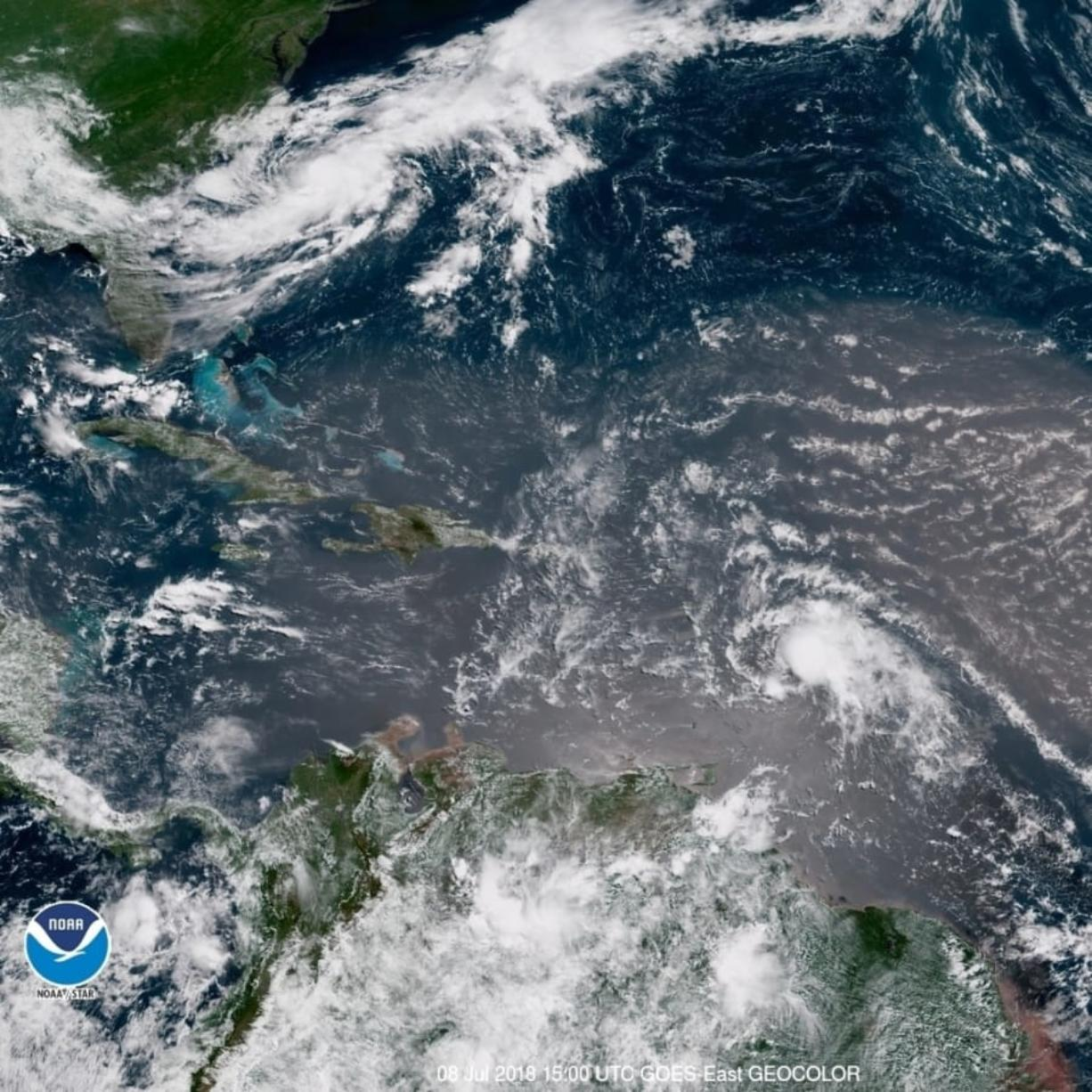 In this geocolor image GOES-16 satellite image taken Sunday, July 8, 2018, at 15:00 UTC, shows Tropical Storm Beryl, center right, moving across the Lesser Antilles in the eastern Caribbean Sea, and Tropical Storm Chris, top left, off the U.S. East Coast.