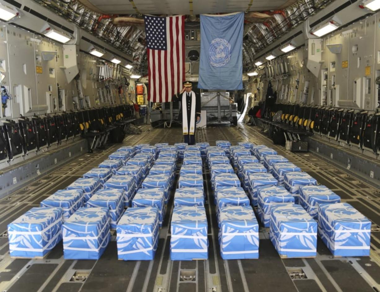 United Nations Command Chaplain U.S. Army Col. Sam Lee performs a blessing Friday on 55 cases of remains believed to be U.S. servicemen killed in the Korean War and returned by North Korea at Osan Air Base in Pyeongtaek, South Korea. Staff Sgt. Quince Lanford/U.S. Army