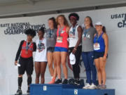 Prairie High track and field athlete Valerie Schmidt, center in red, won the won the heptathlon for ages 17-18 at the USA Track & Field National Junior Olympic Championships, held July 23-24 at Greensboro, N.C.