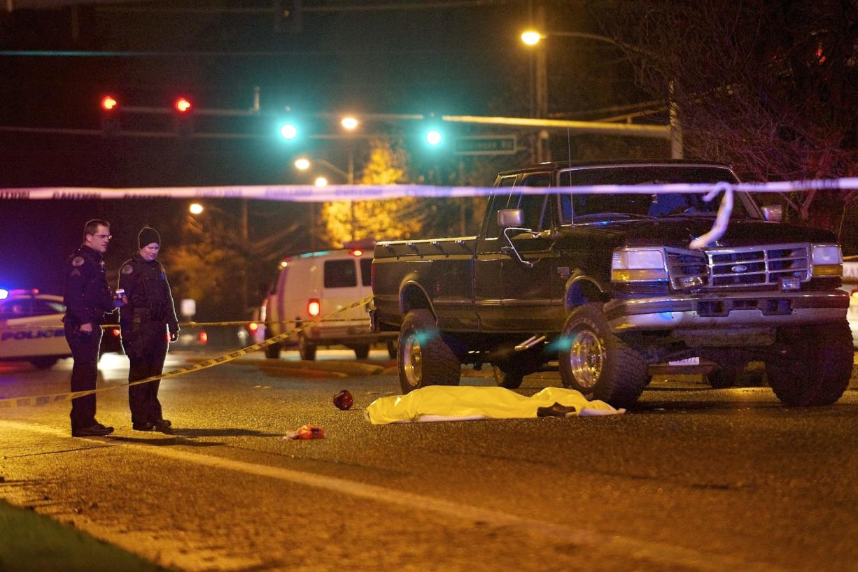Vancouver police investigate the scene where a pedestrian was struck by an automobile and killed in Vancouver in December 2012.
