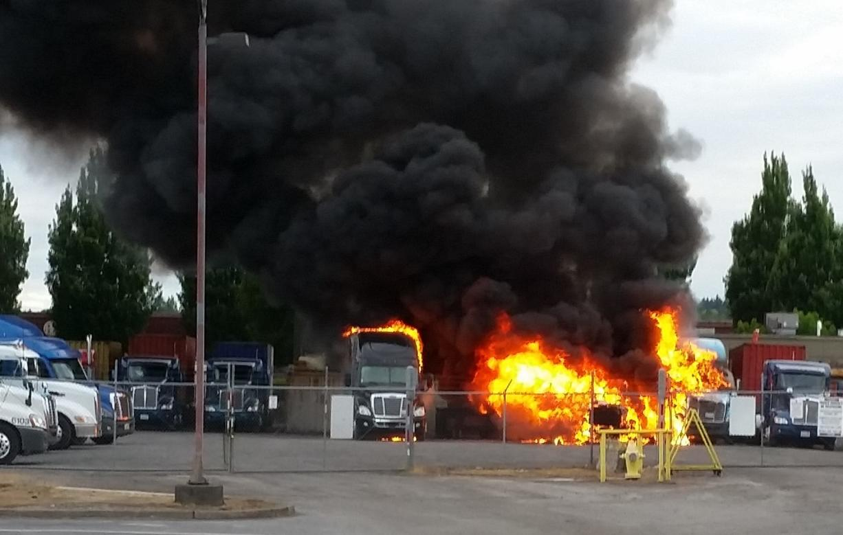 Several trucks burn early Saturday morning at a light industrial park on Southeast Columbia Way in Vancouver.