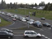 Evening rush hour traffic lines up at the stoplight at the intersection of Highway 500 and Falk Road. Congestion and collisions are a regular feature at the two metered intersections on the highway. WSDOT has released a plan to correct the congestion, possibility as early as this fall.