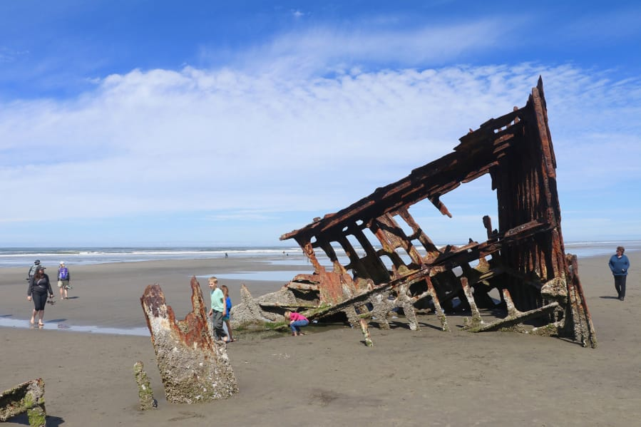 The bare bones of the Peter Iredale, a British four-masted bark that ran aground in 1906, are a magnet for beach visitors to Fort Stevens State Park, Ore.