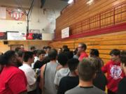 New Fort Vancouver football coach Neil Lomax talks to players on the first day of practice on Aug. 15. More than 50 players turned out for the team, many more than in the previous year.