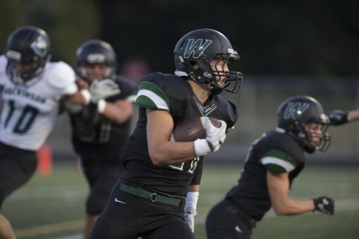 Tyler Flanagan surprised Woodland coaches this spring with how quickly he has become a proficient passer. Amanda Cowan/The Columbian