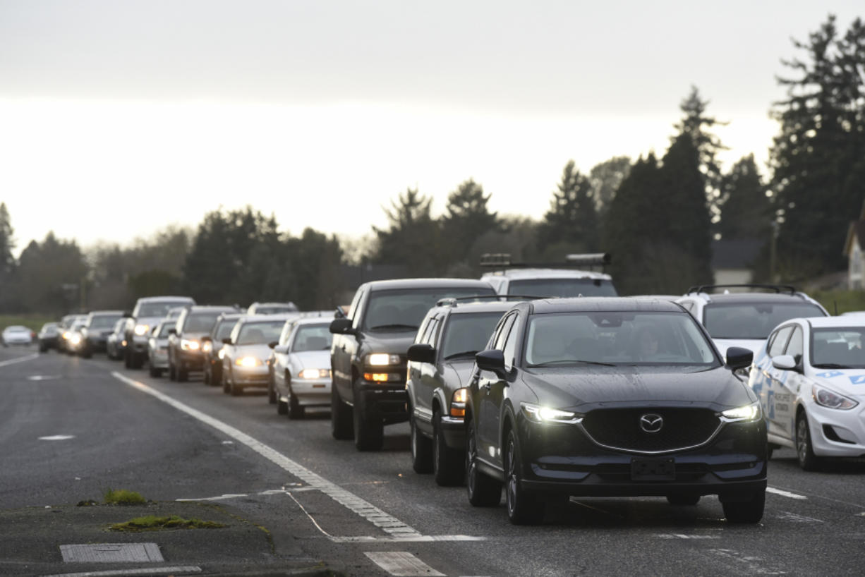 Eastbound vehicles line up just behind the crosswalk along state Highway 500 at the intersection of Northeast Stapleton Road and Northeast 54th Avenue during rush hour earlier this year. Some people worry the Washington State Department of Transportation's plan to close the crossing for several years while it waits to secure funding to build a new, likely above-grade crossing, will temporarily put pedestrians in harm's way.