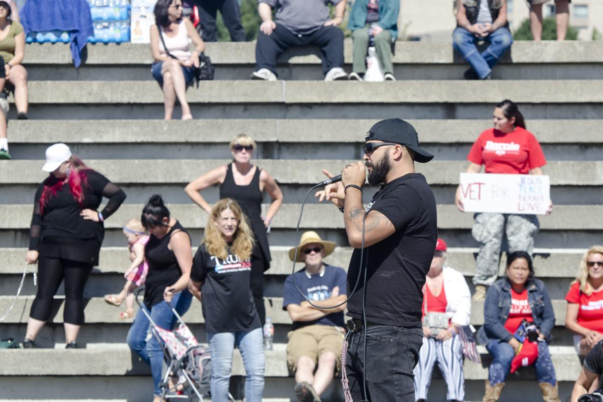 Joey Gibson speaks at a rally held by his Patriot Prayer Group at the Port of Vancouver Amphitheater in September. The event was moved to Vancouver from Portland in an attempt to avoid protesters.