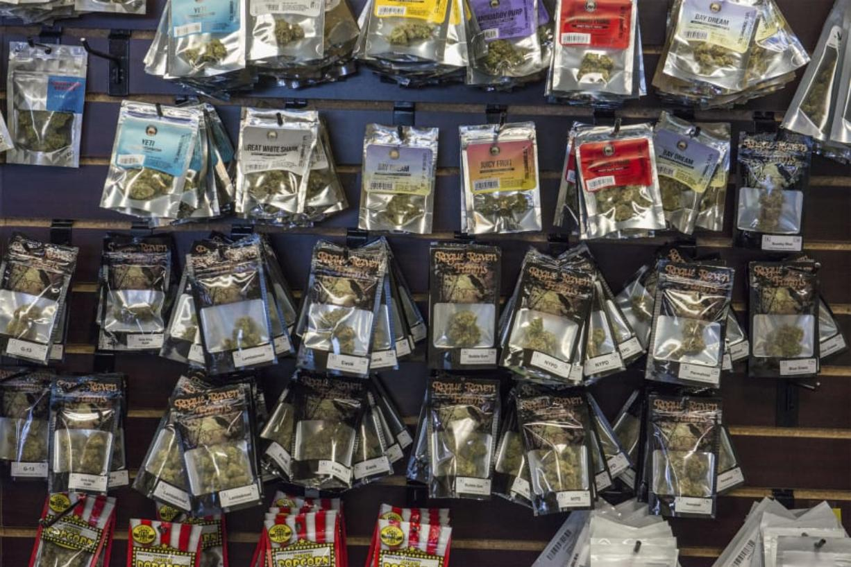 Packaged marijuana products line a wall last month at the now-closed Sticky's Pot Shop in Hazel Dell. (Nathan Howard/The Columbian files)