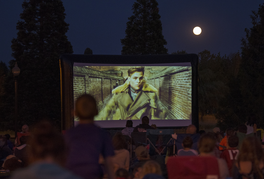 """A full moon glows overhead July 27 as families pack Columbia Tech Center Park to watch the movie """"Wonder Woman"""" underneath the stars. The film, which was free, was part of the Movies in the Park series hosted by the city of Vancouver."""