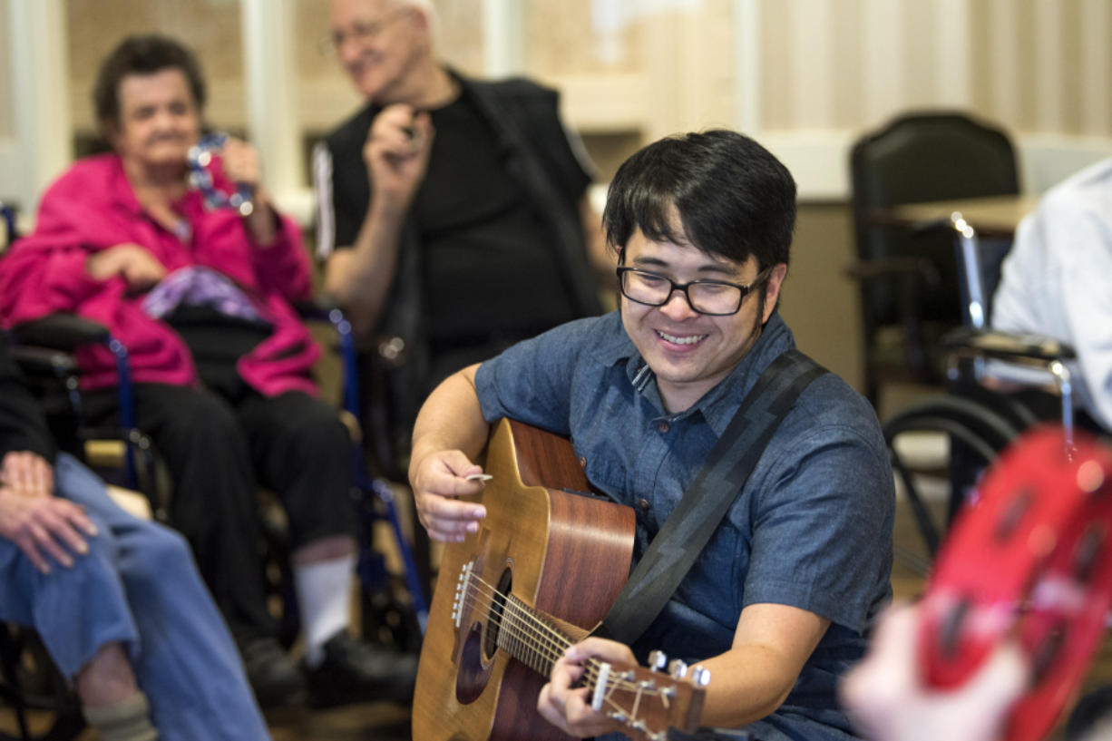 """Daniel Maruyama plays """"Twist and Shout"""" during a weekly music therapy session at The Hampton at Salmon Creek, a memory care facility in Vancouver. Research shows that performing and practicing music can help contain the effects of aging and diseases of the brain, such as dementia. Alisha Jucevic/The Columbian"""