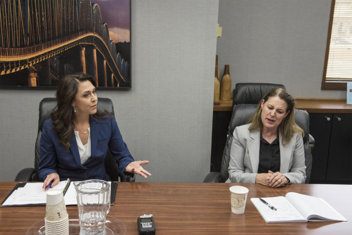 Incumbent U.S. Rep. Jaime Herrera Beutler, R-Battle Ground, left, and Democrat Carolyn Long debate each other for the first time in front of The Columbian's Editorial Board on Aug. 8.