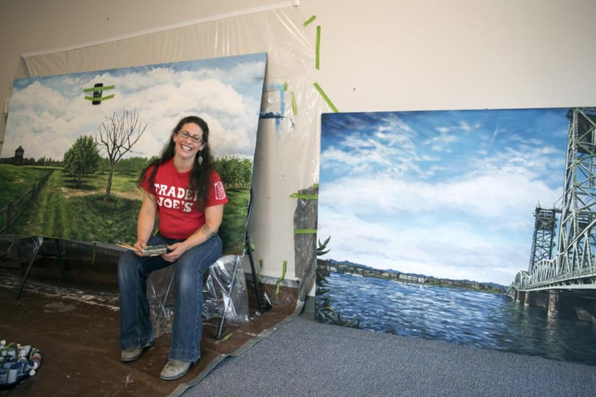 Trader Joe's artist Crystal Humble Lary of Vancouver works on a mural of the Fort Vancouver apple orchard at a workspace near the Vancouver Trader Joe's. Humble Lary paints murals for the store that focus on community landmarks and spaces around the Vancouver area.