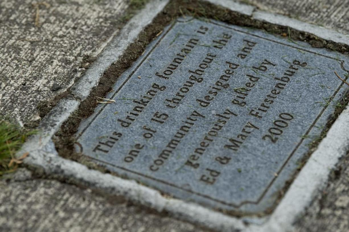 A plaque marks the donation of this Firstenburg drinking fountain, at left, on the Vancouver waterfront.