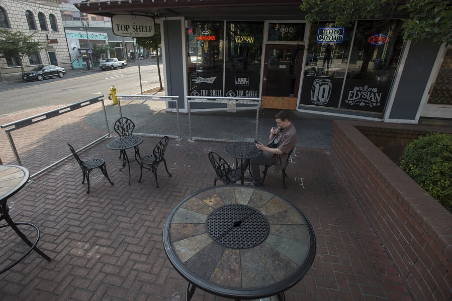 Vancouver Resident Sheldon Gustafson Relaxes With An After Work Drink In  The Outdoor Seating Area