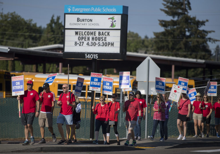 Members of the Evergreen Education Association take to the picket line outside Burton Elementary School on Tuesday morning, Aug. 28, 2018.