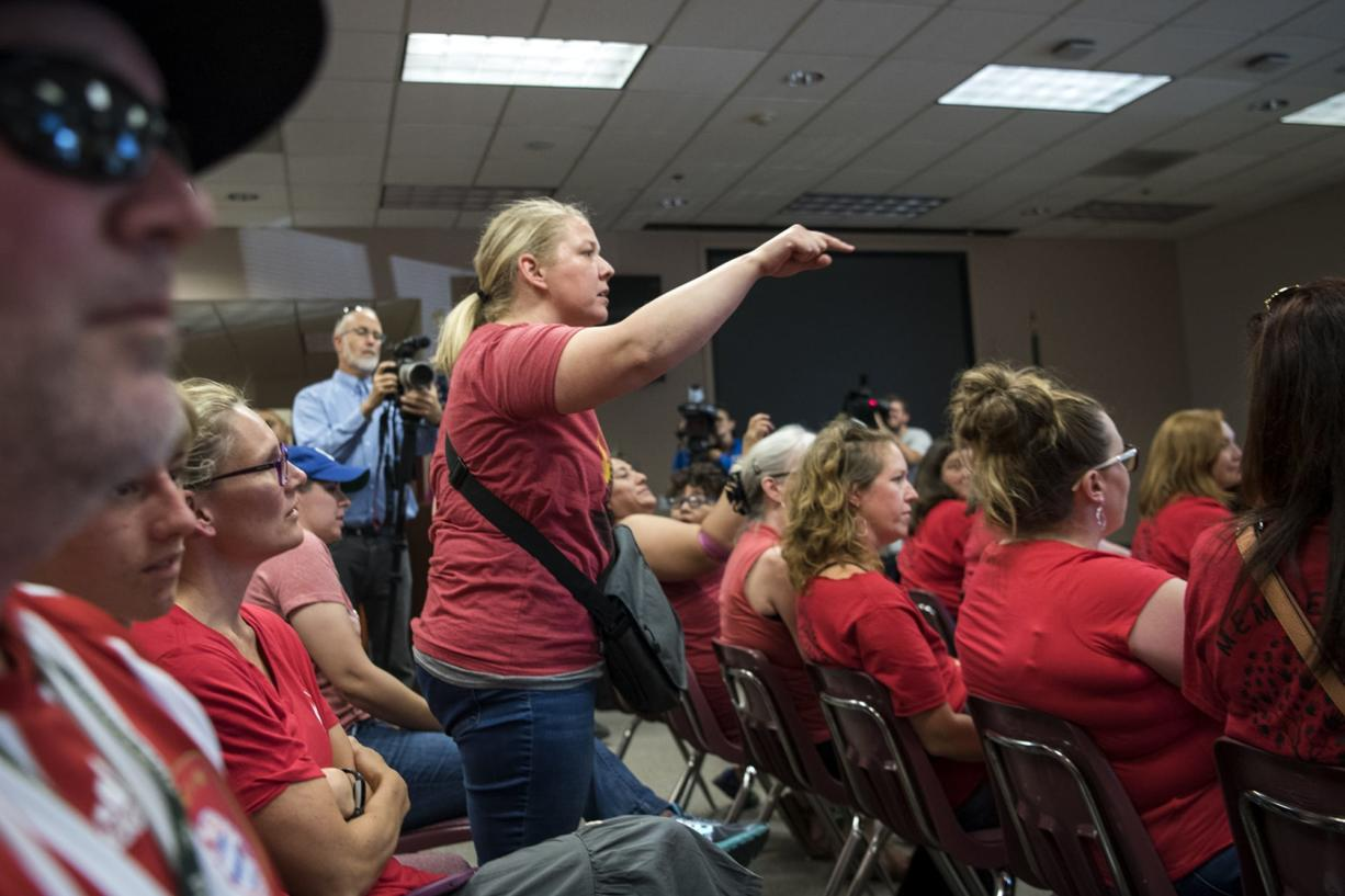 Katie Scot of Vancouver shouts out to the board as they call for a motion to move the meeting into another location during the Vancouver Public Schools board meeting on Tuesday. Scot's son attends Harney Elementary School, and Scot came to the meeting to support the teachers.