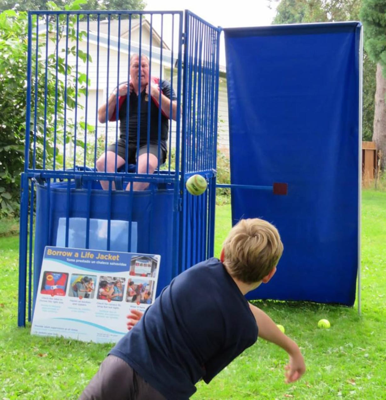 Woodland: Woodland Police Chief James Kelly sits in the dunk tank at the Friends of the Woodland Community Library's second Bocce Ball Blowout tournament to raise funds for a new library building.