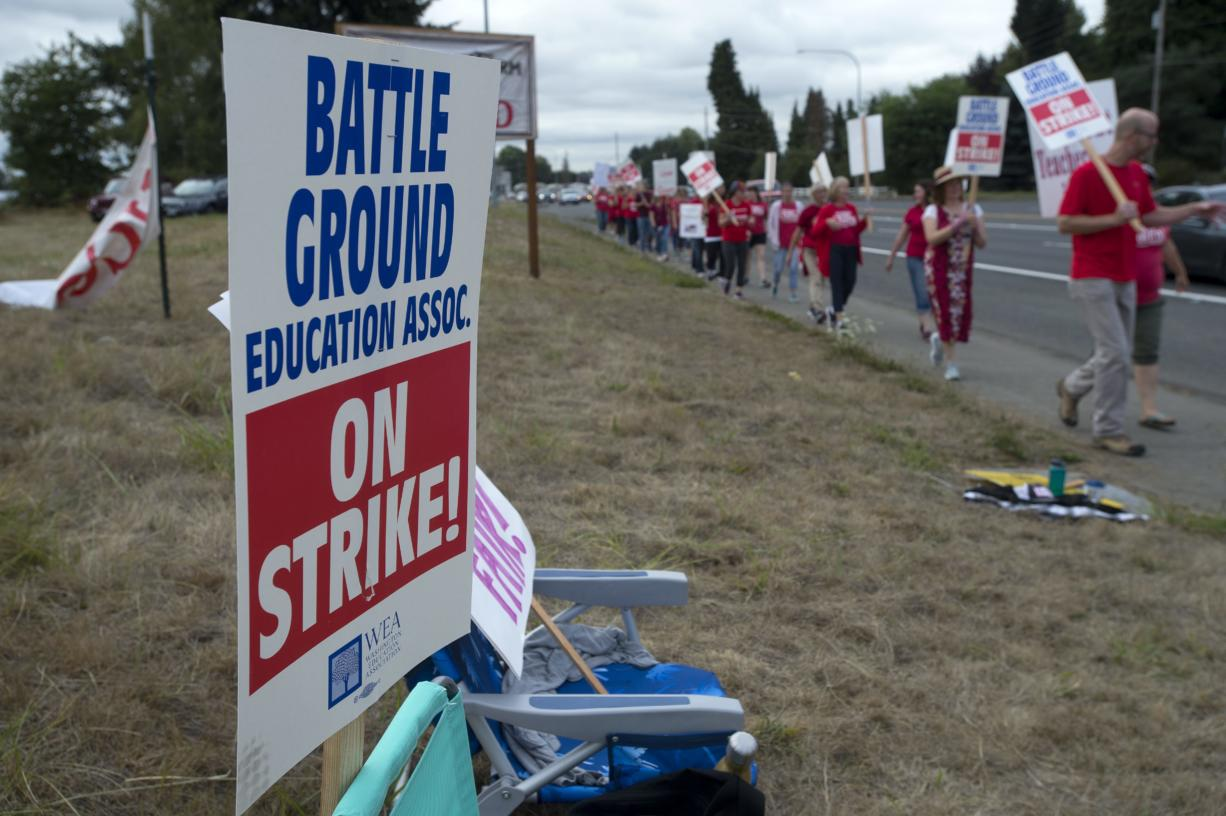 Teachers and supporters from Summit View High School and the CASEE Center greet motorists as they picket along Lewisville Highway on Thursday morning, Aug. 30, 2018.