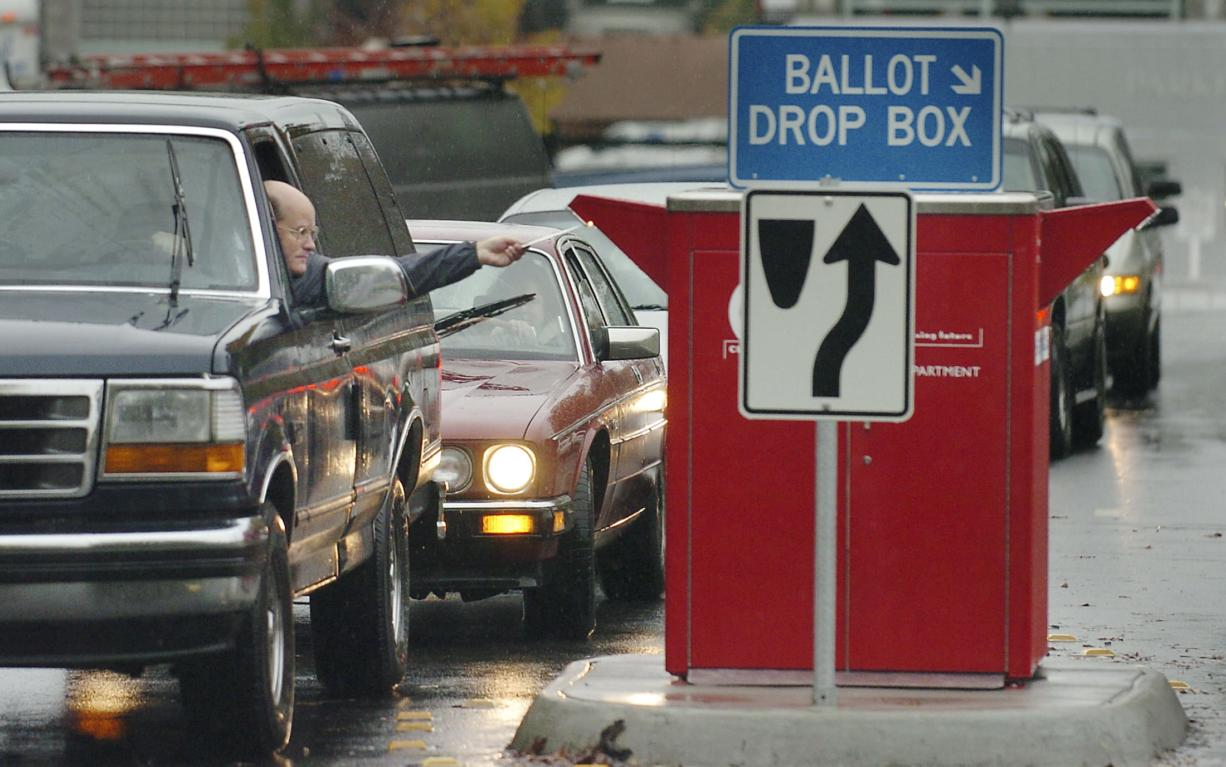 A steady stream of cars visits the ballot drop box at West 14th and Esther streets every major election. With ballots now including prepaid postage, voters do not need to stop by a ballot drop box if they want to return their ballot for free.