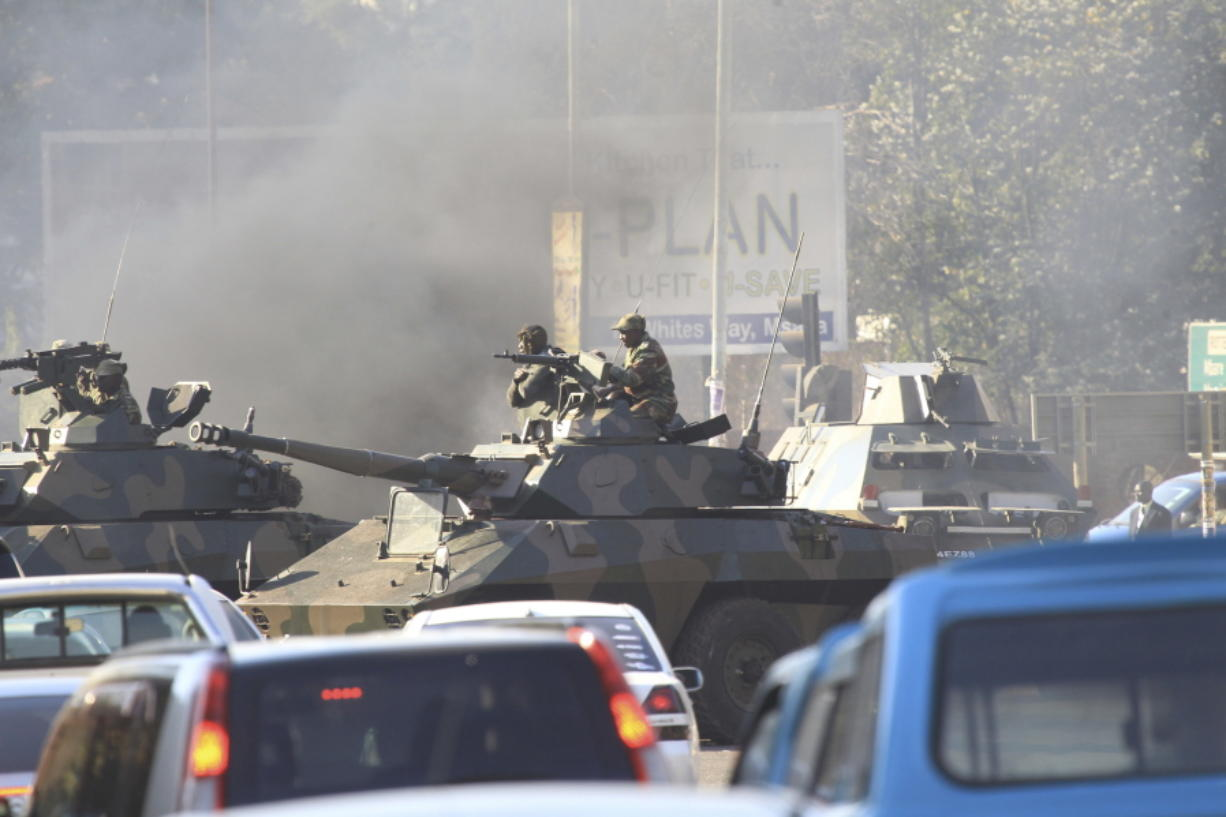 Deadly riots rock Zimbabwe's capital - Columbian com