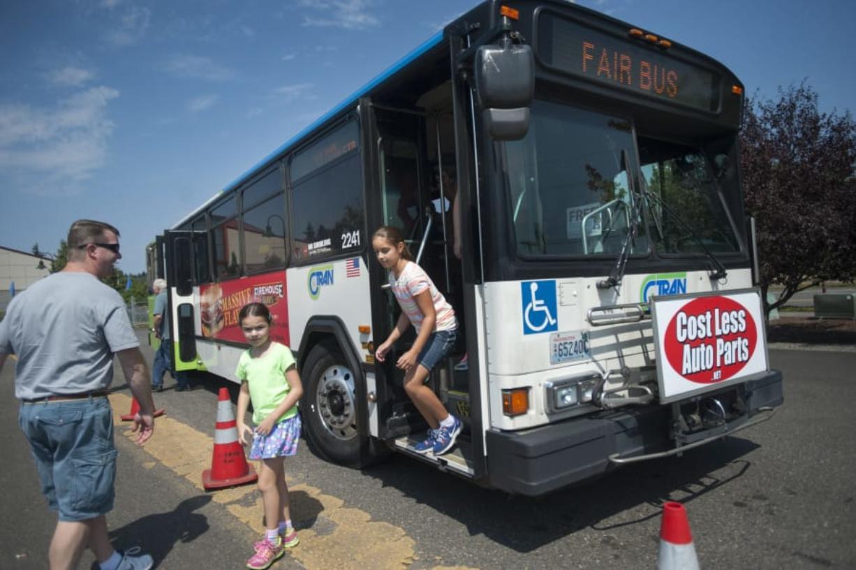 A C-tran bus drops off passengers at the Clark County Fairgrounds in Ridgefield Wednesday August 12, 2015.