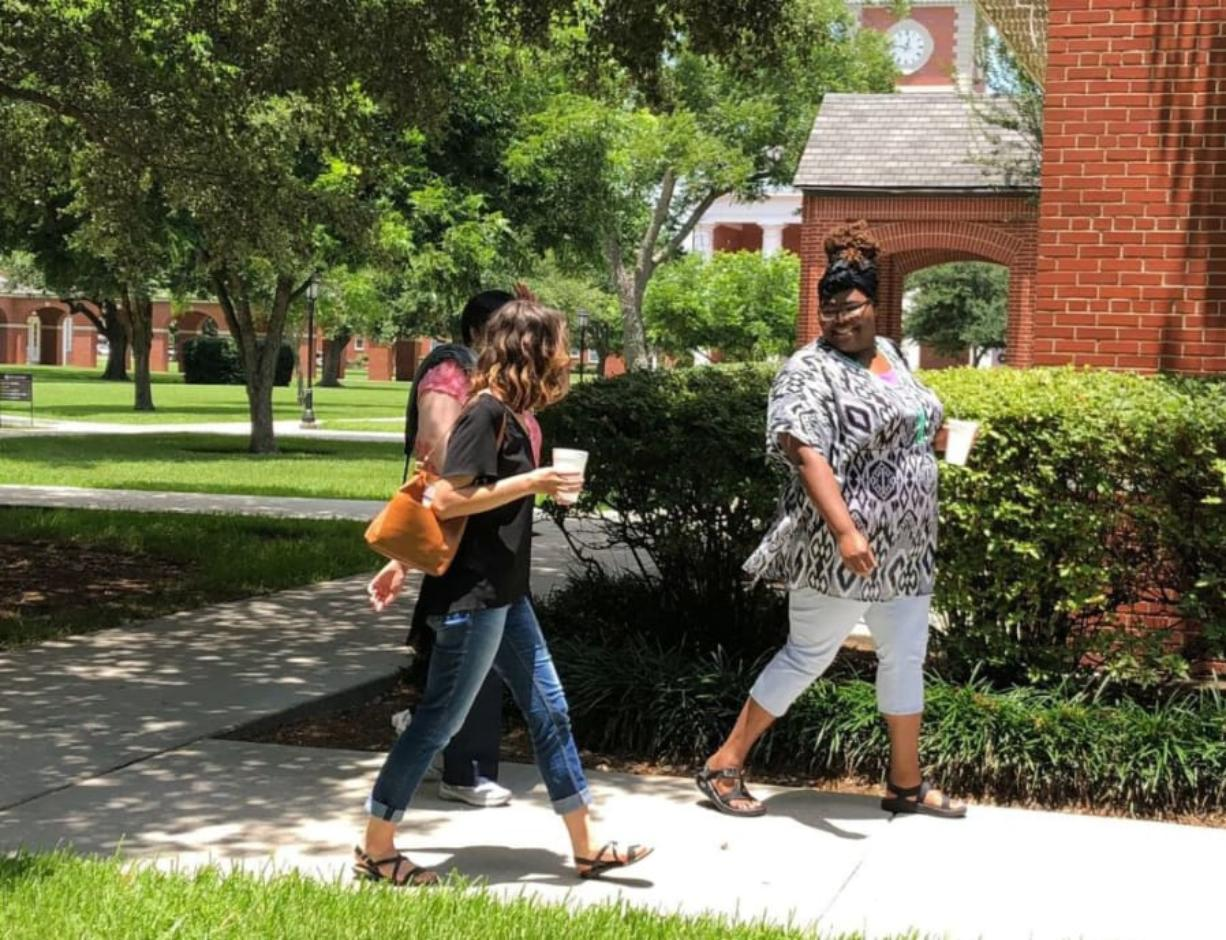 Milly Horsley, left in black shirt, and Gracie Robinson, right, walk to class at New Orleans Baptist Theological Seminary. Julie Zauzmer/The Washington Post