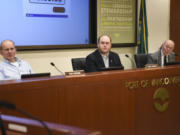 Port of Vancouver's board of commissioners from left, Don Orange, Eric LaBrant and Jerry Oliver, listen to public statements during a board meeting in January.