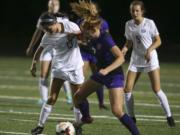 Skyview's Olivia Madden (13) and Columbia River's Reagan Griffith (7) fight for the ball. Skyview beat Columbia River, 1-0, in the the season opener on Sept. 4, 2018 at Columbia River High School in Vancouver. (Randy L.