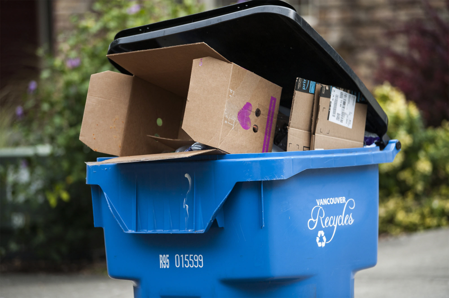 A recycling bin sits outside a Vancouver home. Officials from Clark County, the city of Vancouver and Waste Connections estimate as many as two-thirds of area residents are contaminating their recycling bins with materials that can't be recycled.