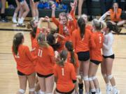 Ridgefield celebrates their win against Woodland during the game in Woodland on Tuesday, Sept. 11, 2018. Ridgefield won in three sets, 25-16, 25-22, 25-17.