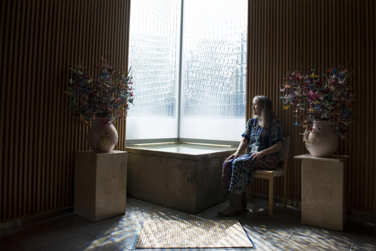 Gwendolyn Morgan, the incoming poet laureate of Clark County and the spiritual care manager at Legacy Salmon Creek Medical Center, enjoys the light that pours through textured glass into the hospital's rooftop chapel. Nathan Howard/The Columbian