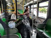 Beginning Sunday, carrying large quantities of cans aboard C-Tran will be prohibited. In this customer-provided photo, a rider carries bags of empty cans onboard The Vine.