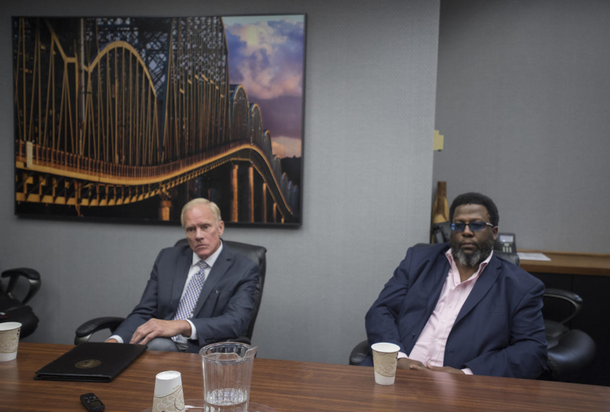 Legislative candidates Paul Harris, left, and Damion Jiles talk with members of The Columbian's Editorial Board about the 17th Legislative District race Wednesday.
