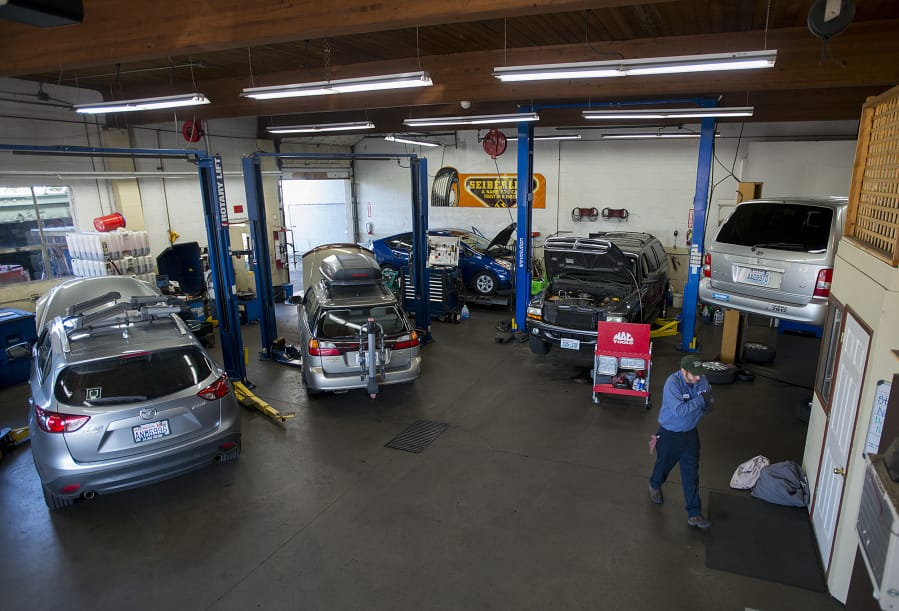 Port of vancouvers orange sells auto repair business the columbian butch brawner of hoesly eco automotive works on vehicles for customers with colleagues tuesday morni solutioingenieria Image collections