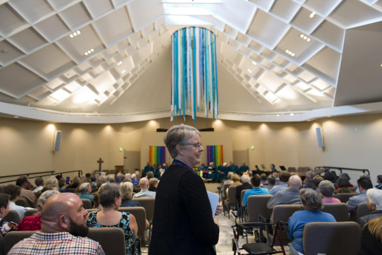Vancouver United Church of Christ Pastor Jennifer Brownell starts proceedings during a rededication ceremony for the church Sunday, after it suffered heavy damage from an arson fire in May 2016.