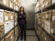 Lindsay Schultz, one of three major crimes detectives in the Clark County Sheriff's Office, stands in the archive room of the sheriff's office.
