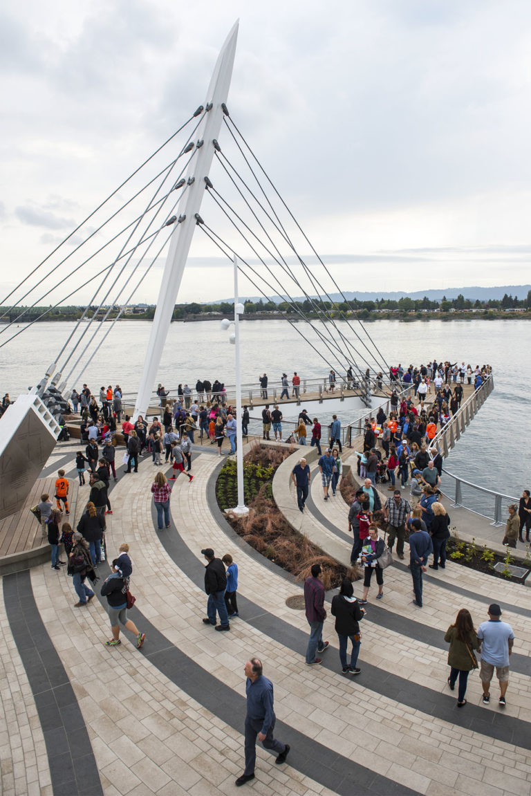 Attendees at the Vancouver Waterfront Park grand opening explore the Grant Street Pier on Saturday afternoon, Sept. 29, 2018. (Nathan Howard/The Columbian)